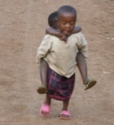 Little girl carrying brother